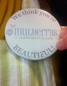 """Mulberrys """"We think you're beautiful"""" buttons"""